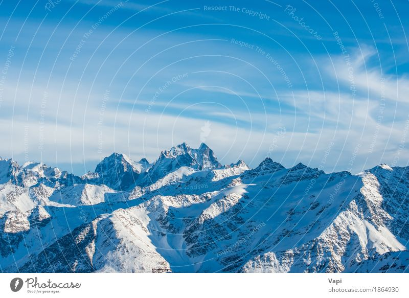 Snowy blue mountains with peaks in clouds Sky Nature Vacation & Travel Blue White Landscape Clouds Winter Mountain Black Rock Tourism Ice Action Vantage point