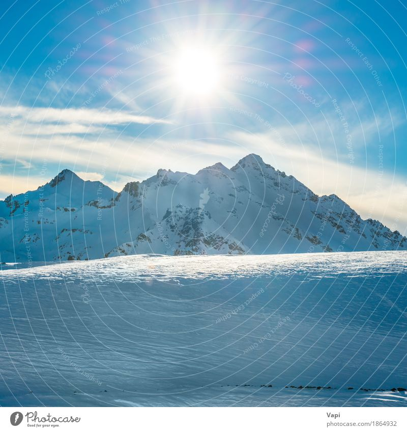 Snowy blue mountains in clouds at sunset Vacation & Travel Tourism Adventure Sun Winter Winter vacation Mountain Climbing Mountaineering Skis Nature Landscape