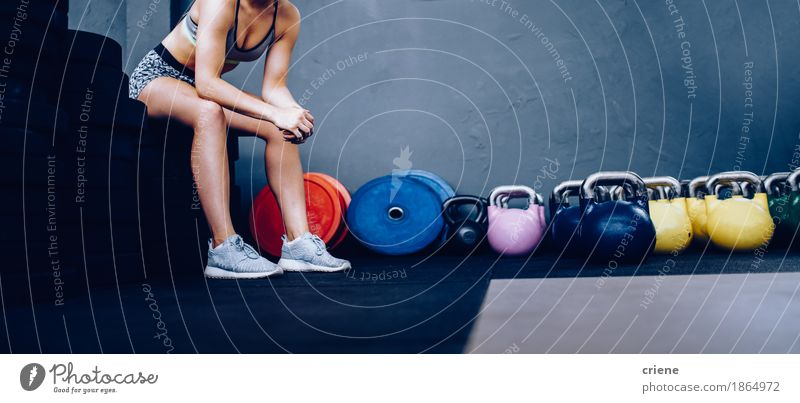 Detail of Girl resting sitting on weights in Gym Human being Youth (Young adults) Young man Life Lifestyle Sports Leisure and hobbies Copy Space Sit Fitness Athletic Sports Training Musculature Hard Sports equipment Lift