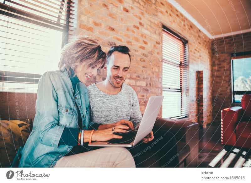 Mother and son browsing together on laptop House (Residential Structure) Joy Adults Lifestyle Family & Relations Laughter Business Together Office Modern Technology Computer Smiling Mother Team Couch