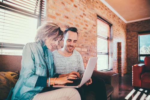 Mother and son browsing together on laptop House (Residential Structure) Joy Adults Lifestyle Family & Relations Laughter Business Together Office Modern