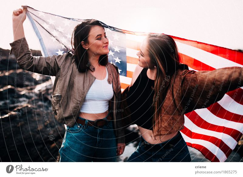Teenage girls holding USA flag outdoor Vacation & Travel Youth (Young adults) Young woman Joy Beach 18 - 30 years Adults Funny Lifestyle Freedom Feasts & Celebrations Tourism Friendship Trip 13 - 18 years Happiness