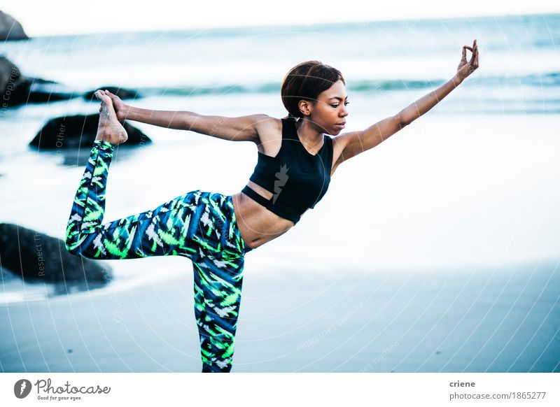 African women doing yoga pose on beach in early morning Lifestyle Beautiful Body Athletic Fitness Wellness Harmonious Relaxation Calm Meditation