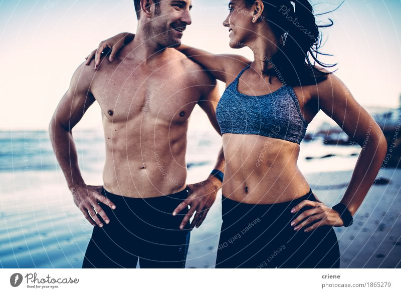 Close-up of young adult's muscular bodies on the beach Youth (Young adults) Young woman Young man Eroticism Joy Beach 18 - 30 years Adults Life Lifestyle Sports