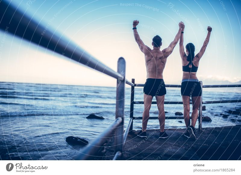 Young adult caucasian couple doing conquer pose after run Human being Youth (Young adults) Young woman Young man Joy Beach 18 - 30 years Adults Life Lifestyle Sports Healthy Happy Freedom Feasts & Celebrations Couple