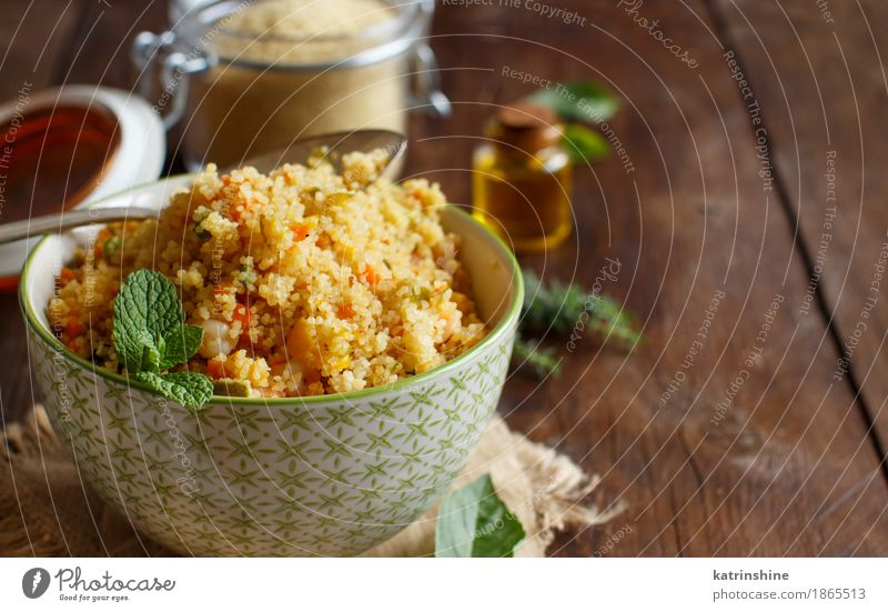 Couscous with shrimps and vegetables in a bowl Seafood Vegetable Grain Lunch Dinner Bowl Spoon Brown Yellow Tradition Africa african Algerian Arabia Cooking