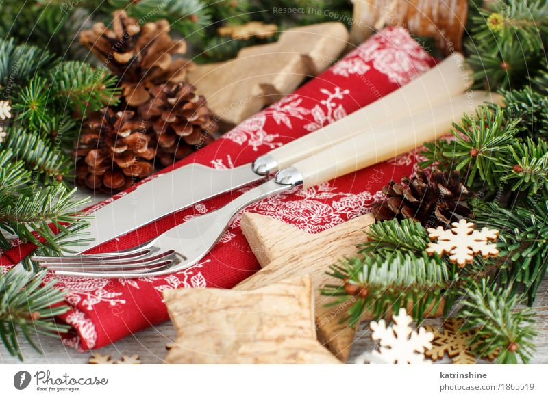 Rustic festive table setting with fork and knife Dinner Knives Fork Winter Decoration Feasts & Celebrations New Year's Eve Tree Wood Ornament Brown Green Red