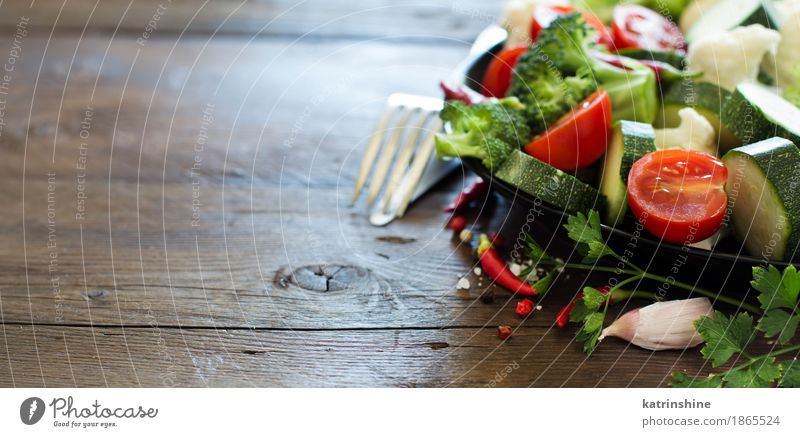 Fresh vegetables on a wooden table Vegetable Herbs and spices Eating Vegetarian diet Diet Fork Summer Table Leaf Dark Healthy Natural Yellow Green agriculture