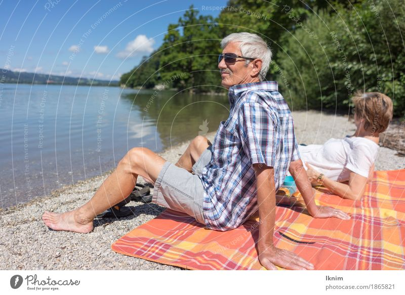 Seniors sit together at Kochelsee Well-being Contentment Relaxation Calm Vacation & Travel Tourism Trip Summer Sun Female senior Woman Male senior Man