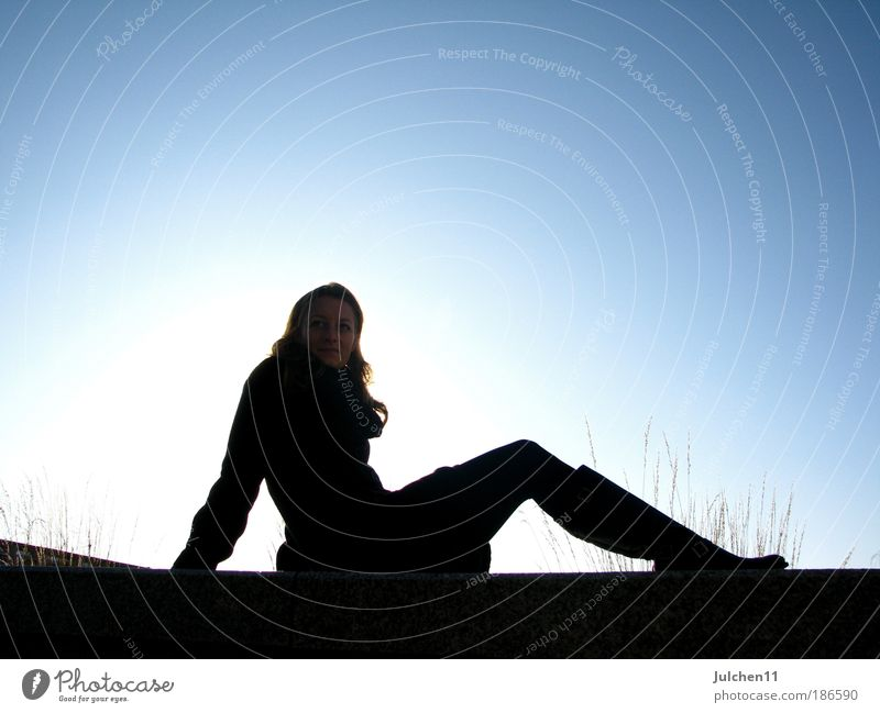 Human being Youth (Young adults) Blue Calm Black Feminine Free Sit Hope Woman Longing Illuminate Friendliness Young woman