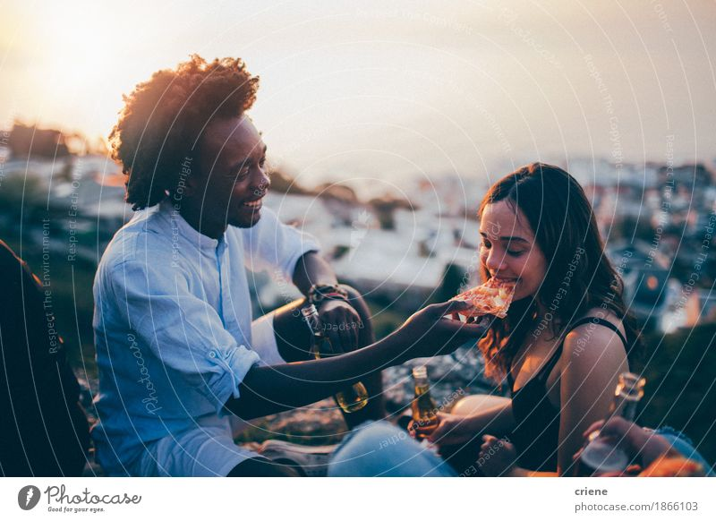 Couple eating pizza at date night in sunset Youth (Young adults) Young woman Young man Joy 18 - 30 years Adults Eating Lifestyle Laughter Feasts & Celebrations Party Couple Together Friendship Birthday Happiness