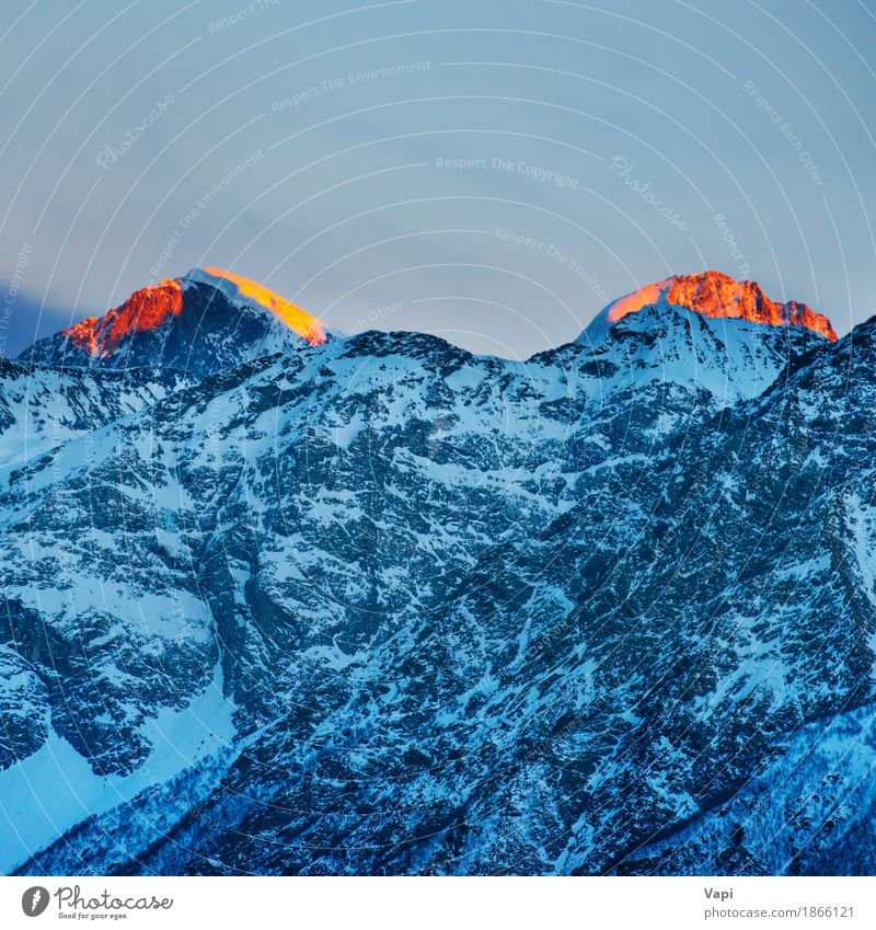 Red sunset on mountain peaks Sky Nature Vacation & Travel Blue White Sun Landscape Red Clouds Winter Mountain Environment Yellow Snow Rock Tourism