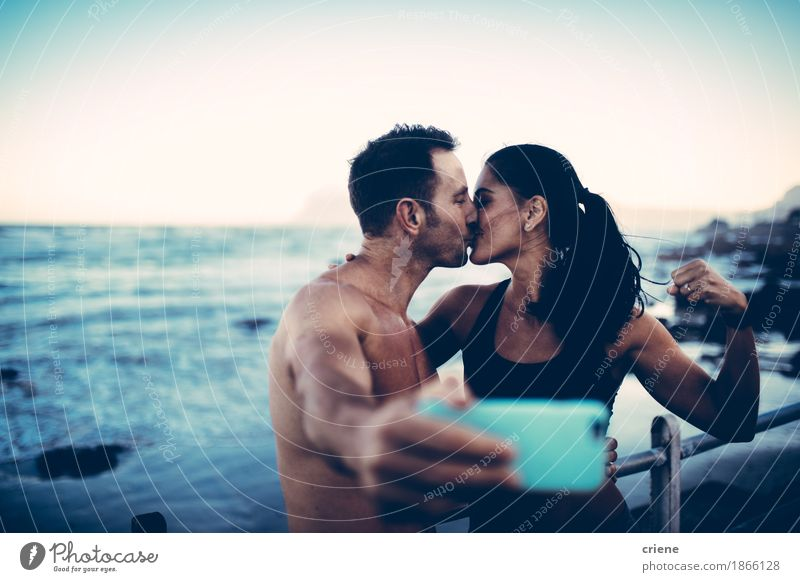 Fit couple taking selfie with smart phone after workout Human being Youth (Young adults) Ocean Joy Beach Lifestyle Sports Healthy Couple Leisure and hobbies
