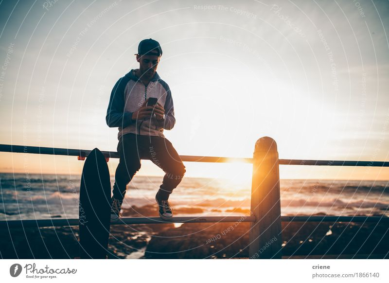 Hipster guy sitting on railing browsing with his smart phone Human being Youth (Young adults) Summer Young man 18 - 30 years Adults Lifestyle Masculine Leisure and hobbies Copy Space Modern Sit Technology Wait Telephone Internet