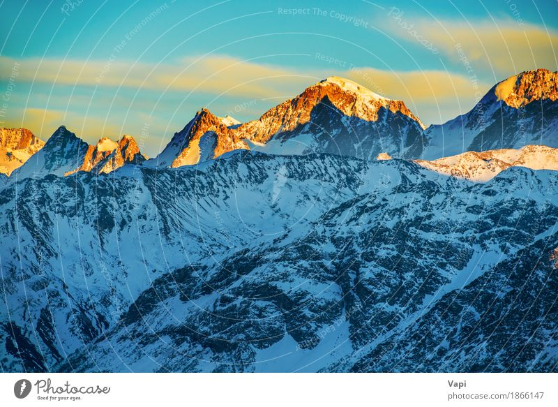 Beautiful sunset at the mountains Sky Nature Vacation & Travel Blue White Sun Landscape Red Clouds Winter Mountain Black Yellow Snow Rock Tourism