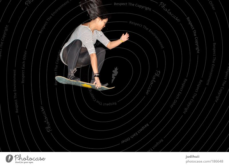 One Penguin Joy Leisure and hobbies Sports Snowboard Skateboarding Feminine Young woman Youth (Young adults) 1 Human being Shows Rotate Flying Exceptional