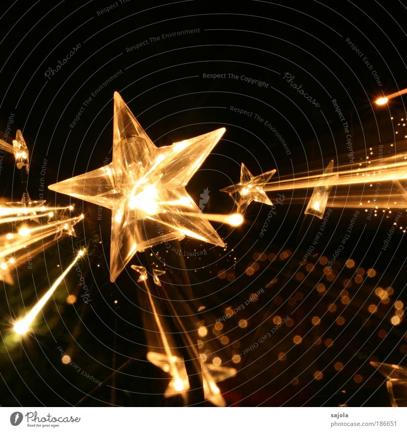 Christmas & Advent Black Gold Esthetic Star (Symbol) Decoration Visual spectacle Anticipation Motion blur Christmas decoration Christmas star Point of light