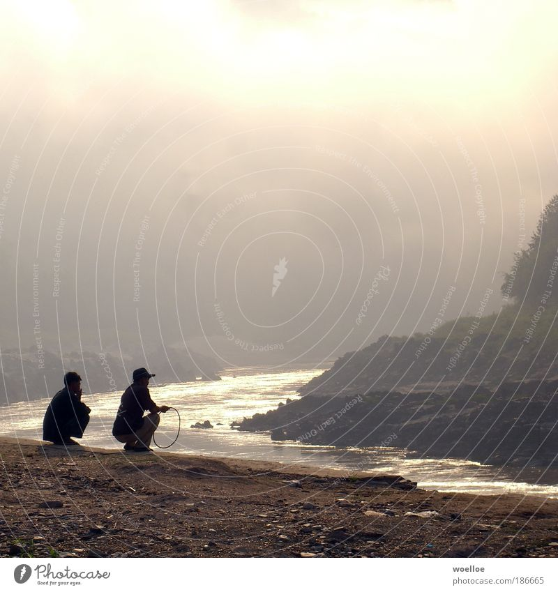Human being Nature Water Clouds Sand Landscape Bright Moody Wait Fog Masculine Poverty Rock River Smoking Asia