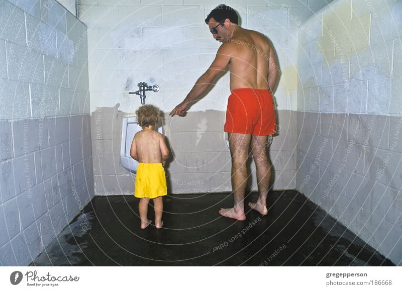 Father and son in public restroom. Family & Relations Child Parents Adults Boy (child) Help Team Education Curiosity Toddler Discover Stress Indicate