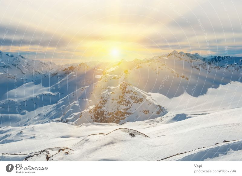 Sunset in snowy blue mountains with clouds Vacation & Travel Tourism Adventure Winter Snow Winter vacation Mountain Nature Landscape Sky Clouds Sunrise Sunlight