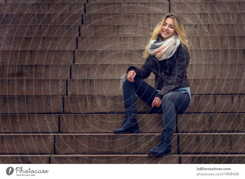 Smiling stylish woman sitting on a flight of concrete steps Style Happy Face Relaxation Business Woman Adults Fashion Suit Scarf Brunette Sit Dark Happiness