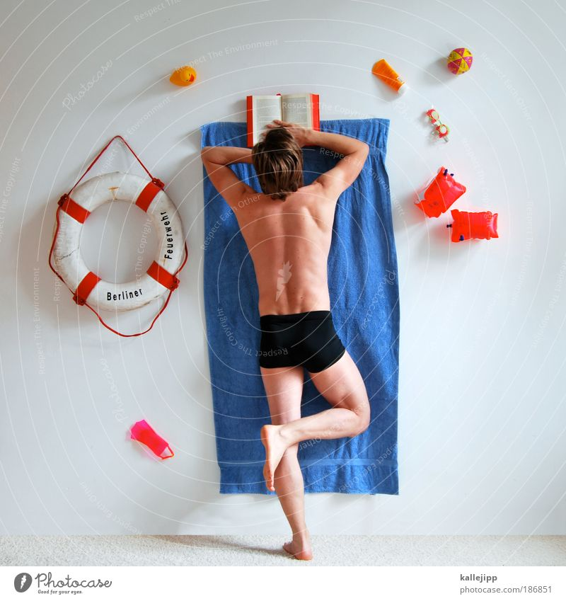 holiday in(-house) Lifestyle Wellness Relaxation Calm Spa Leisure and hobbies Reading Swimming pool Man Adults 1 Human being Whimsical Towel Life belt