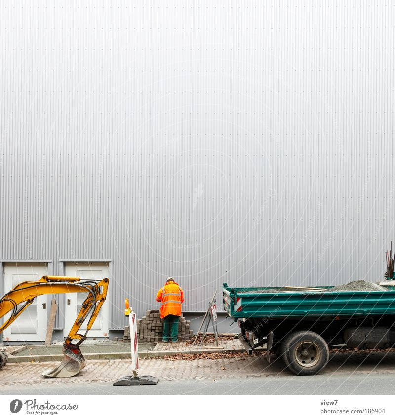 stimulus package Craftsperson Construction site Tool Machinery Masculine Man Adults 1 Human being Wall (barrier) Wall (building) Facade Transport Street Truck