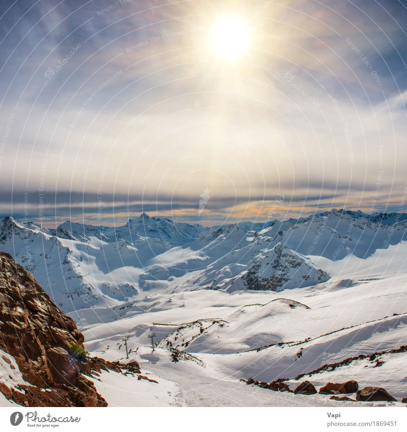 Snowy blue mountains in clouds at sunset Sky Nature Vacation & Travel Blue White Sun Landscape Red Clouds Winter Mountain Black Yellow Snow Brown Rock