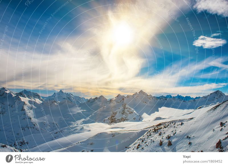 Sunset in snowy blue mountains with clouds Sky Nature Vacation & Travel Blue White Landscape Clouds Winter Mountain Black Yellow Snow Rock Tourism Orange