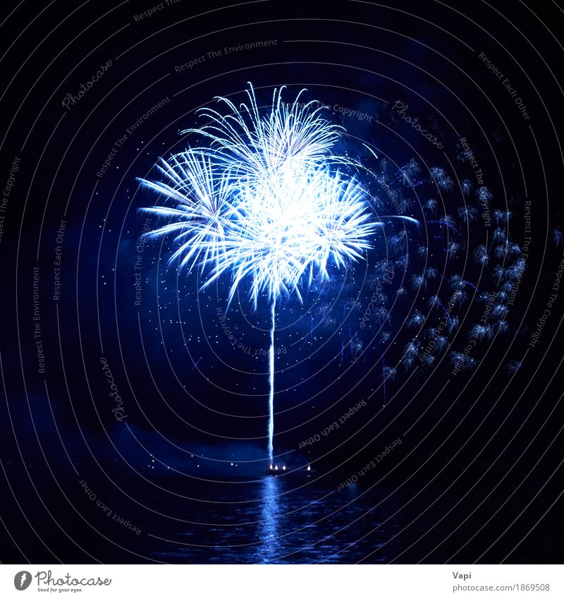 Blue fireworks with water reflection Joy Freedom Night life Entertainment Party Event Feasts & Celebrations Christmas & Advent New Year's Eve Art Shows Water