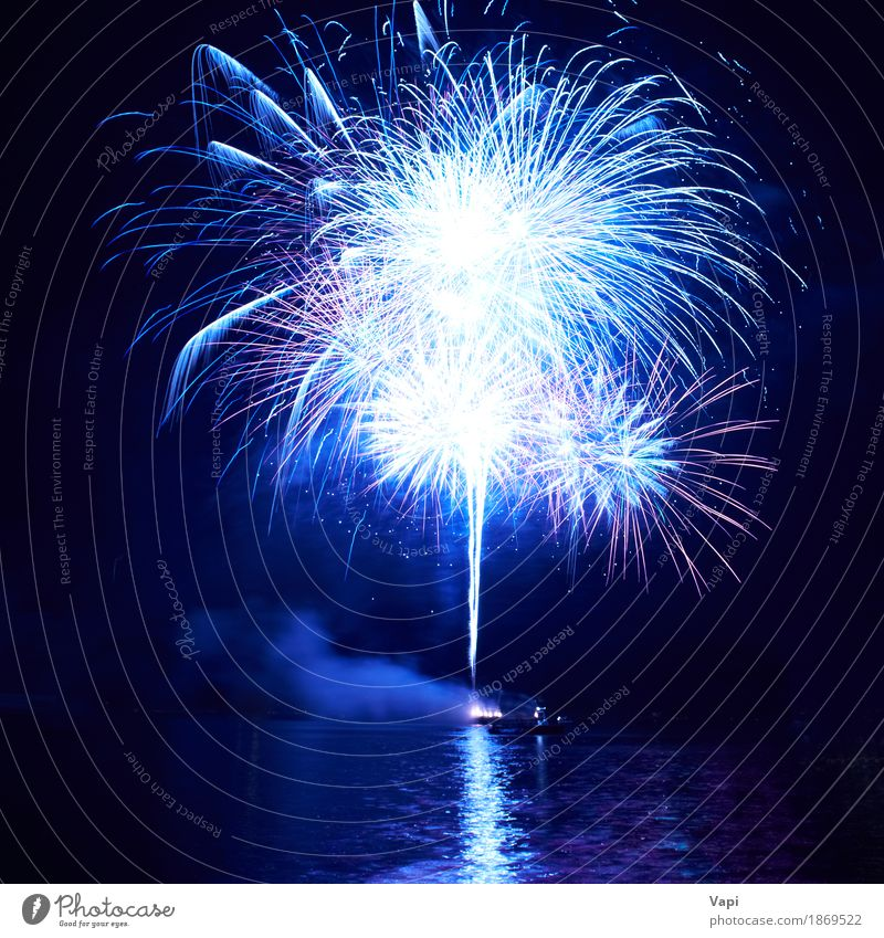 Blue fireworks with water reflection Joy Freedom Night life Entertainment Party Event Feasts & Celebrations Christmas & Advent New Year's Eve Art Water Sky