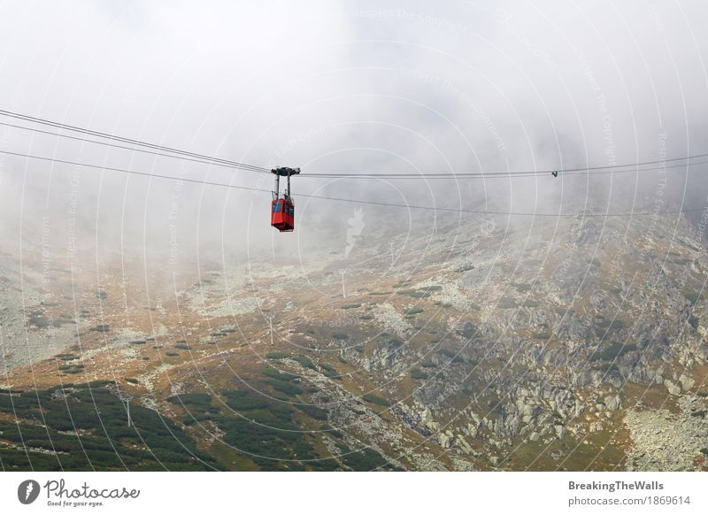 Red mountain cable way car in clouds and fog Nature Vacation & Travel Beautiful Landscape Red Clouds Far-off places Mountain Movement Freedom Tourism Leisure and hobbies Transport Weather Fog Air
