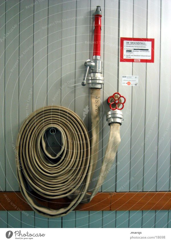 In case of fire Extinguisher Hose Lever Hang Red Wall (building) Burn Emergency Accident Industry Fear Panic Help Blaze coiled Fire department Tap