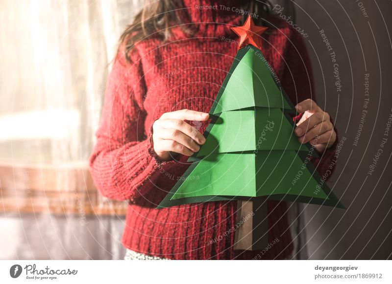 Woman in red sweater hold fir christmas tree Human being Christmas & Advent Beautiful Tree Red Girl Winter Adults Happy Feasts & Celebrations Decoration Seasons