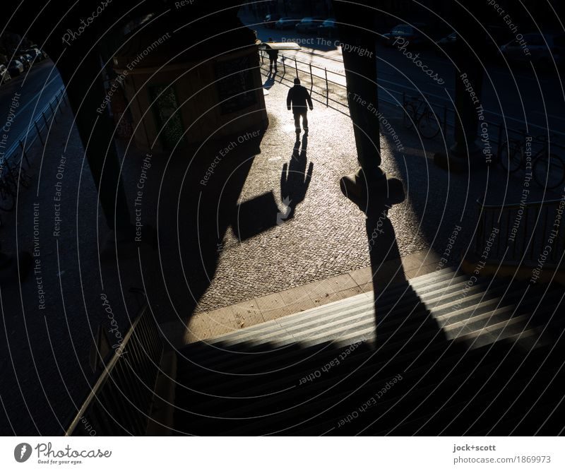 unknown man moves in the light out of the darkness Architecture Stairs Column Pedestrian Lanes & trails Going Exceptional Moody Inspiration Shadow play Abstract