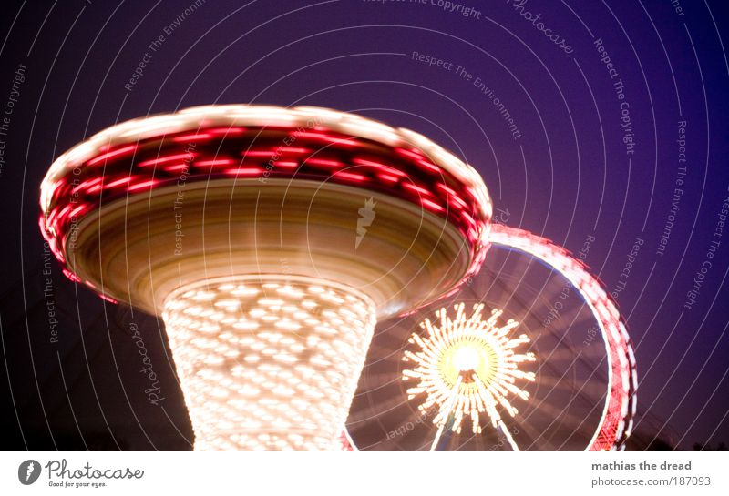 Christmas market Night life Movement Rotate Exceptional Bright Kitsch Beautiful Fairs & Carnivals Christmas Fair Carousel Ferris wheel Light Multicoloured Blur