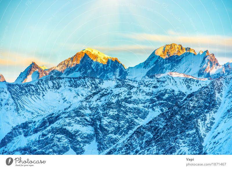 Sunset in mountains Sky Nature Vacation & Travel Blue White Landscape Red Clouds Winter Mountain Black Yellow Snow Rock Tourism