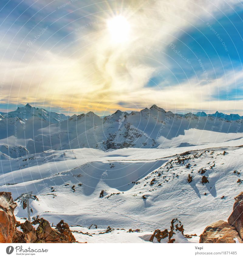 Snowy blue mountains with peaks in clouds Sky Nature Vacation & Travel Blue Beautiful White Sun Landscape Clouds Winter Mountain Black Yellow Snow Brown Rock
