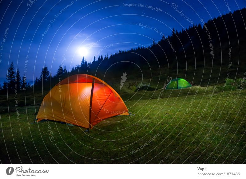 Two Illuminated orange and green camping tents under moon Sky Nature Vacation & Travel Blue Green White Tree Landscape Red Clouds Dark Forest Mountain Black Yellow Meadow