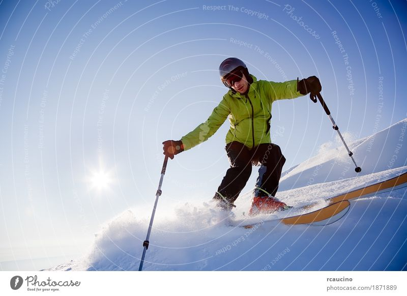 Freeride skier Sun Winter Snow Mountain Sports Skiing Boy (child) Man Adults Landscape Sky Cold Blue Green Loneliness Afternoon back-light Clear sky Extreme