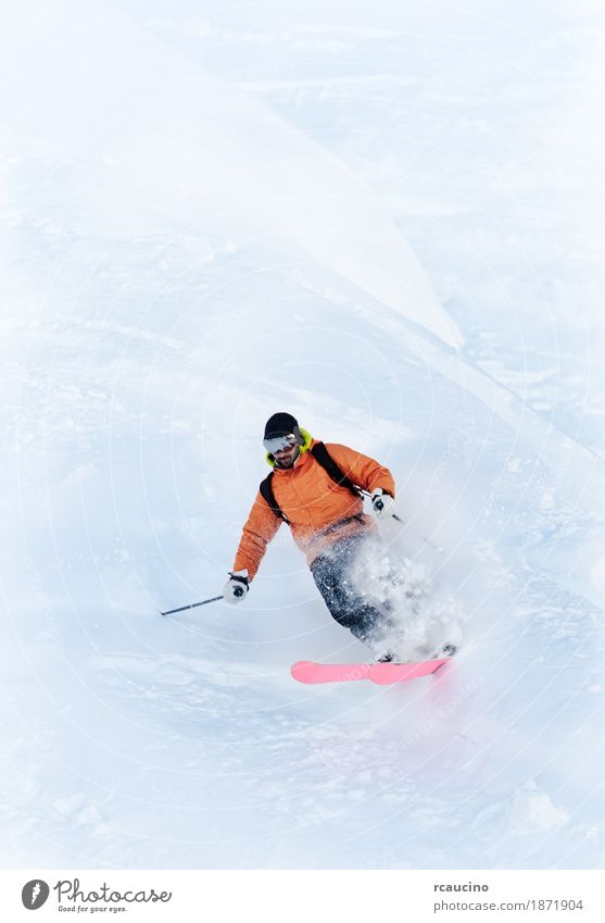 Young male freeride skier making a turn in powder snow Man White Winter Mountain Adults Sports Snow Skiing Vertical Skier Extreme Caucasian Turn on the lathe