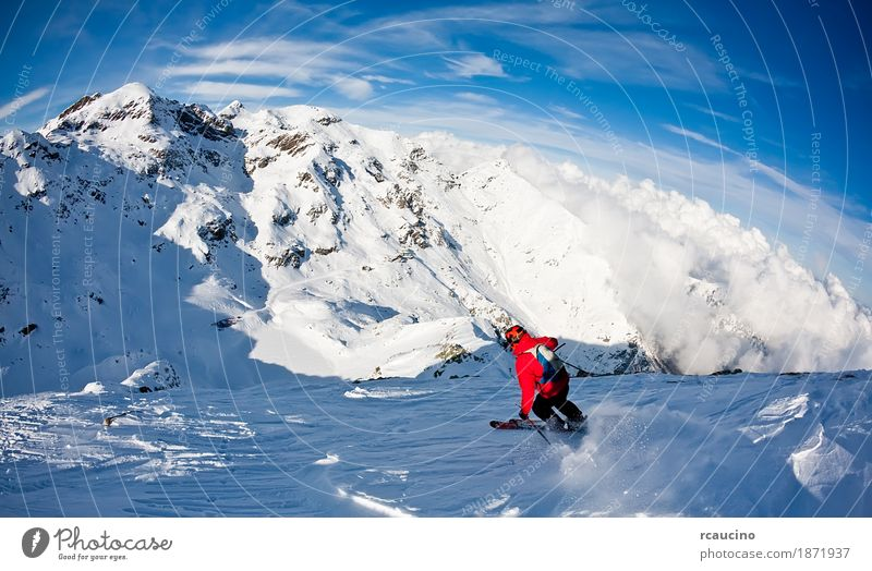 Man's skiing downhill in fresh snow. West Alps, Italy Sky Blue Landscape Red Winter Mountain Adults Sports Snow Boy (child) Skiing Frozen Jacket Horizontal