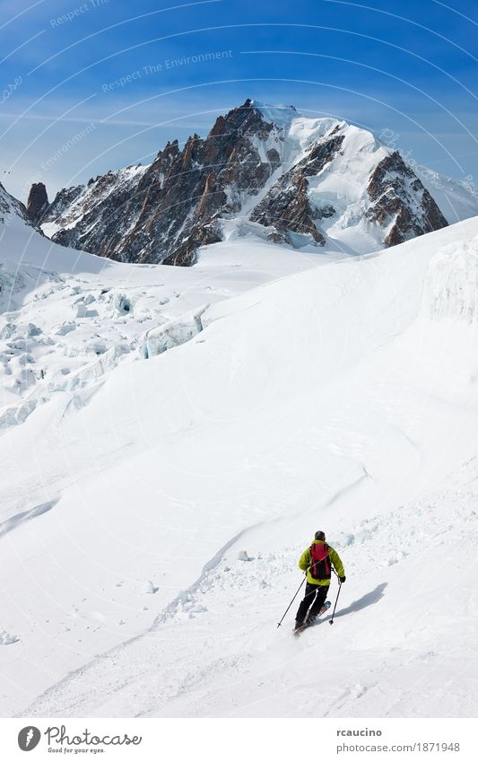 Male skier moving down in snow powder Joy Adventure Winter Snow Mountain Sports Skiing Man Adults Landscape Sky Glacier Green Clear sky Extreme freeride