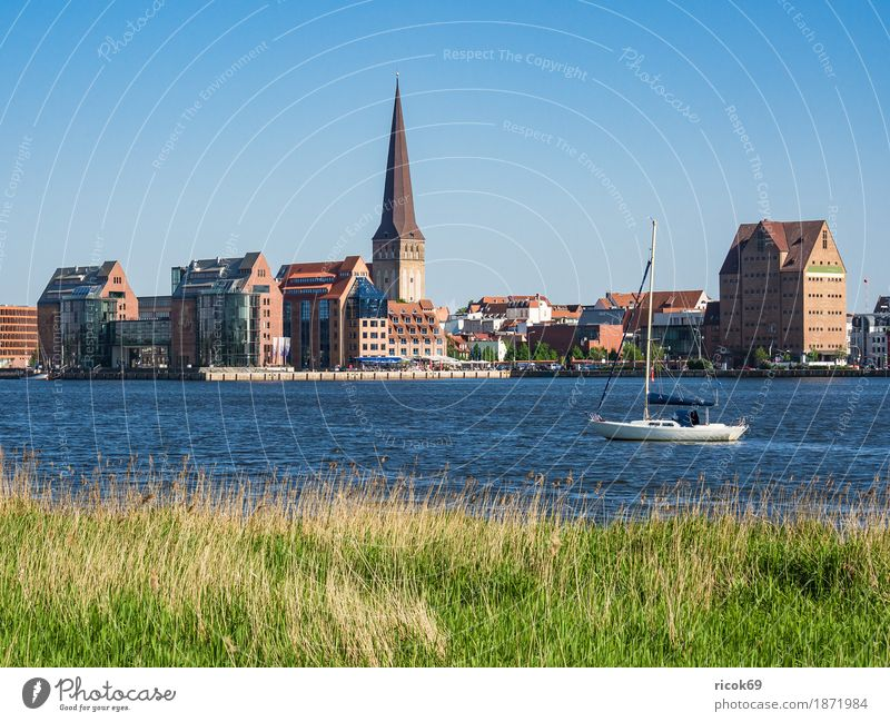 View over the Warnow to the Hanseatic city of Rostock Vacation & Travel Tourism Sailing Water Cloudless sky River Town Harbour Architecture Sailboat