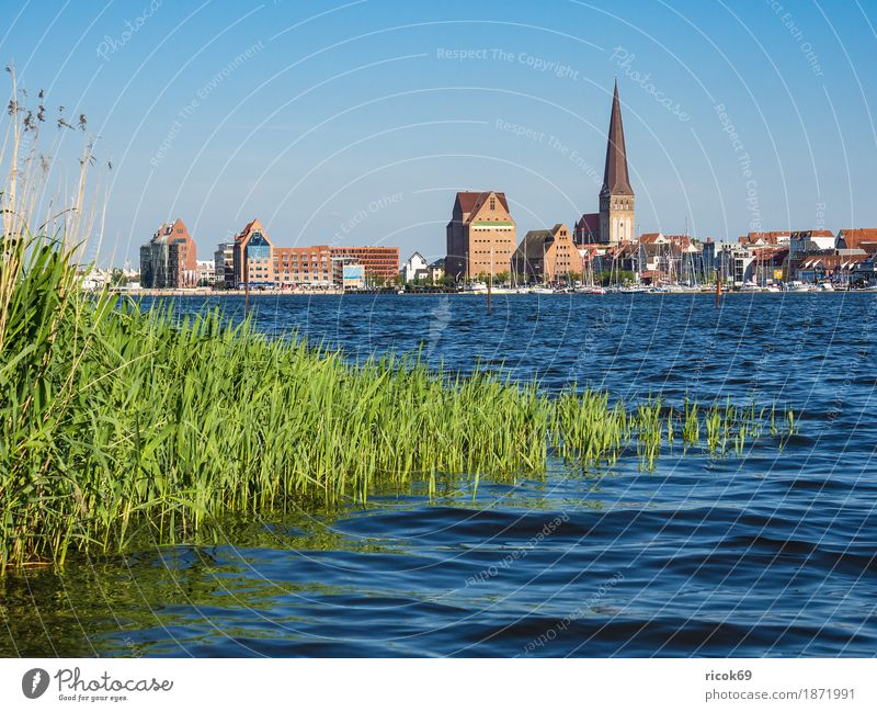 View over the Warnow to the Hanseatic city of Rostock Relaxation Vacation & Travel Tourism Nature Landscape Water Cloudless sky River Town Harbour Architecture