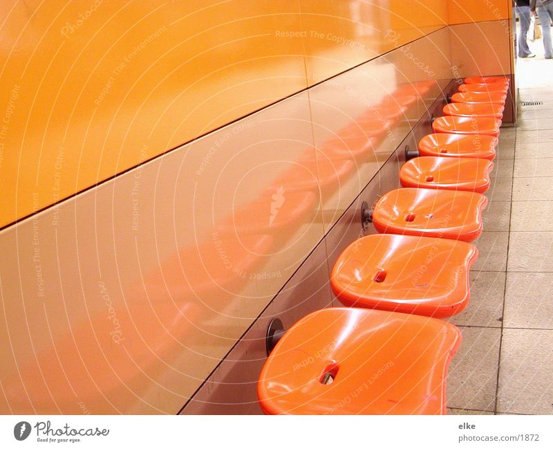 seating Seventies Seating Photographic technology Statue Orange Human being
