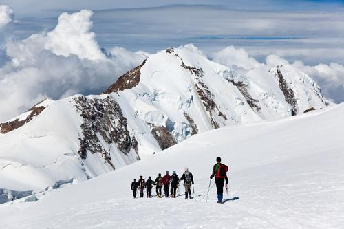 Mountaneers walking on the Monte Rosa glacier, Switzerland Woman Man Summer White Landscape Clouds Winter Mountain Adults Snow Sports Hiking Europe Dangerous
