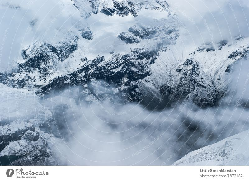 Misty Mountains [3] Winter sports Climbing Mountaineering Hiking Landscape Elements Fog Ice Frost Snow Rock Alps Peak Snowcapped peak Cold Gray Black White