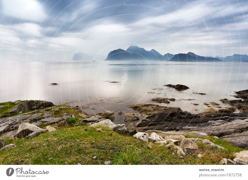 Summer cloudy Lofoten islands. Norway misty sea Vacation & Travel Tourism Far-off places Ocean Island Mountain Nature Landscape Sky Clouds Weather Storm Fog
