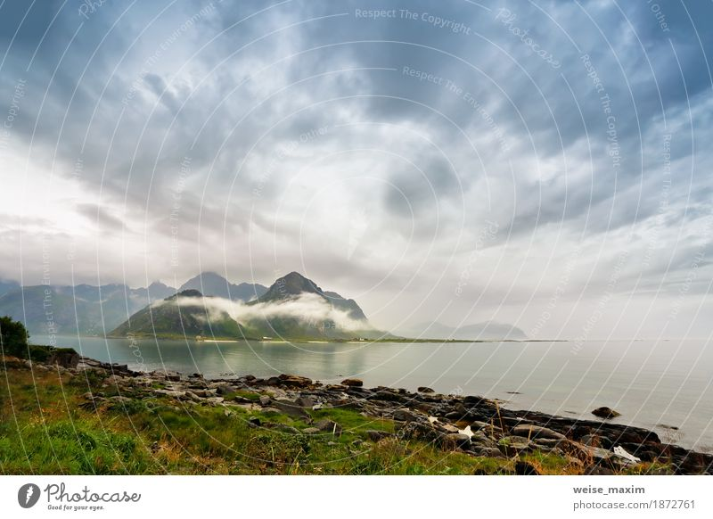 Norway lofoten islands in clouds of fog Sky Nature Vacation & Travel Summer Ocean Landscape Clouds House (Residential Structure) Beach Mountain Lifestyle Natural Coast Rock Tourism Rain